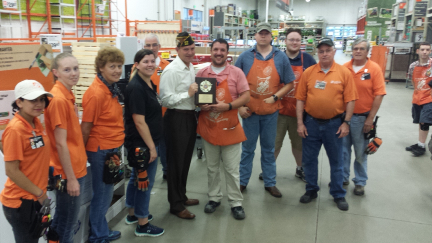 Presented a plaque to Home Depot for their donation of a BBQ Grill for a donation.