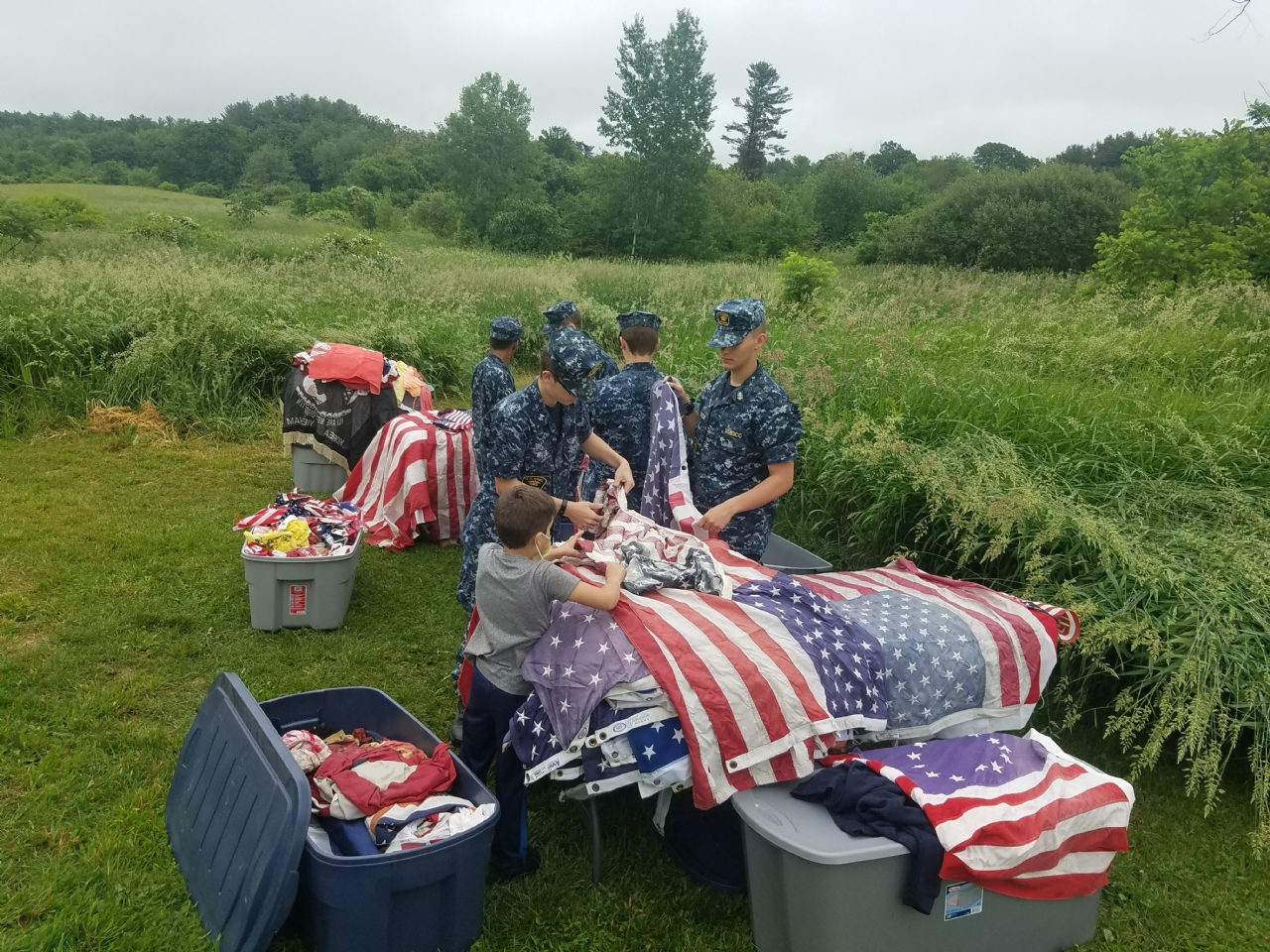 Sea Cadets and Joshwa Perkins sorting flags