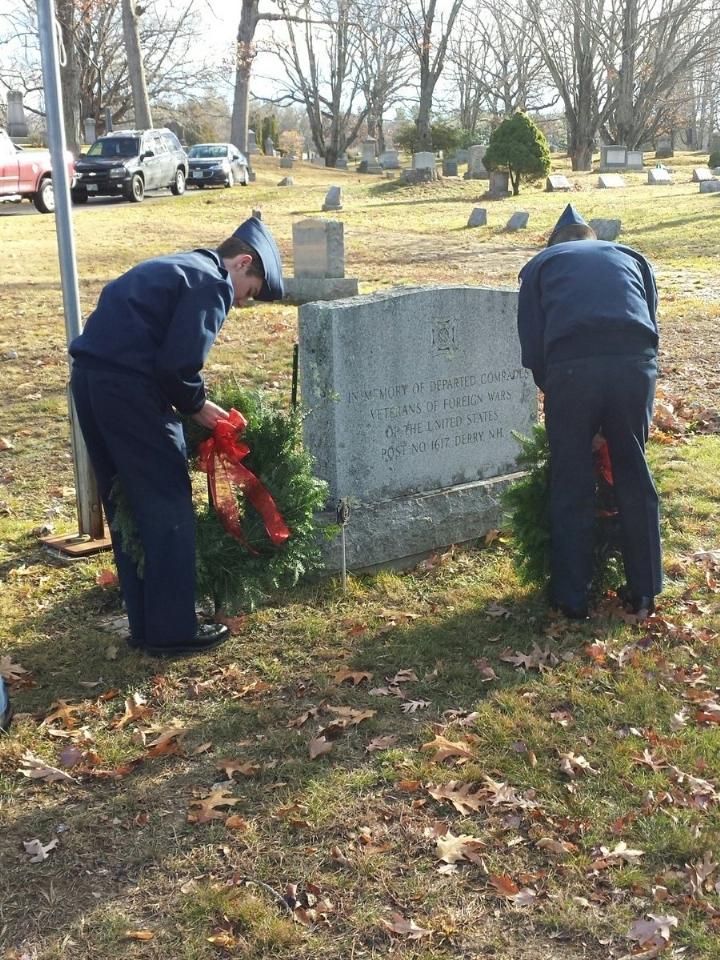 AFJROTC Cadets place the wreaths at VFW Lower Memorial at Forrest Hills Cemetery.
