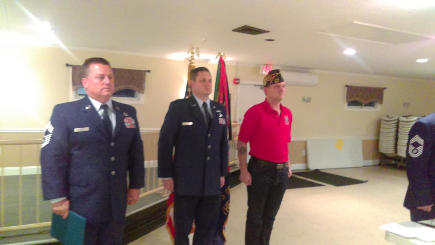 Lt Bates and CMSGTs Dubuc and Voto Read and Present CDR Perkins his retirement medals.